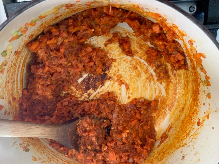 Caramelizing the tomato paste for added flavor