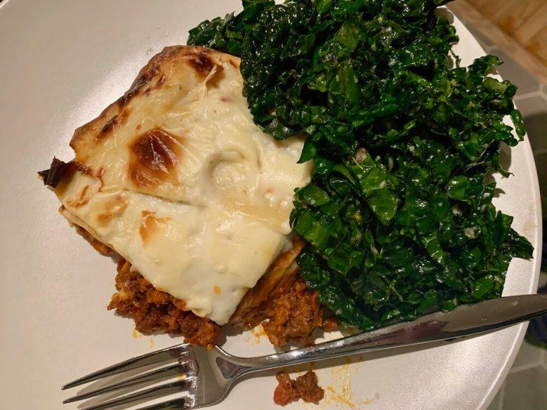 Lasagna served with a Caesar slaw