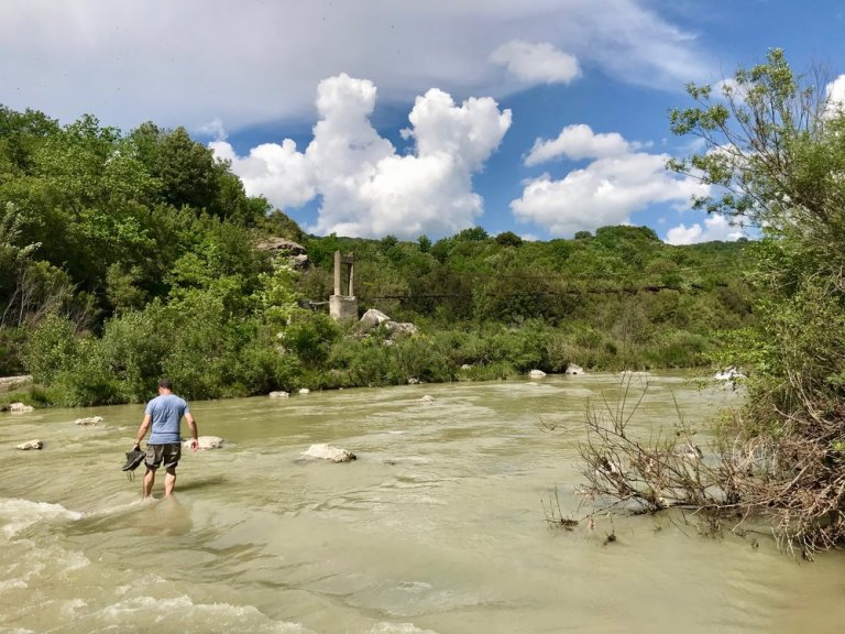 Inching my way across the ford in the Orcia river
