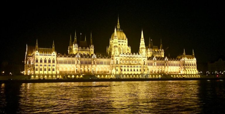 The Hungarian Parliament during a night cruise on the Danube in Budapest